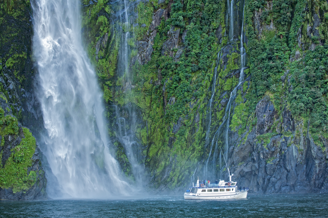 Tour Boat At Waterfall Milford Sound Fiordland National Park