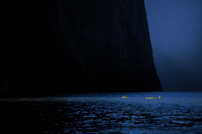 Kayakers dwarfed on Milford Sound