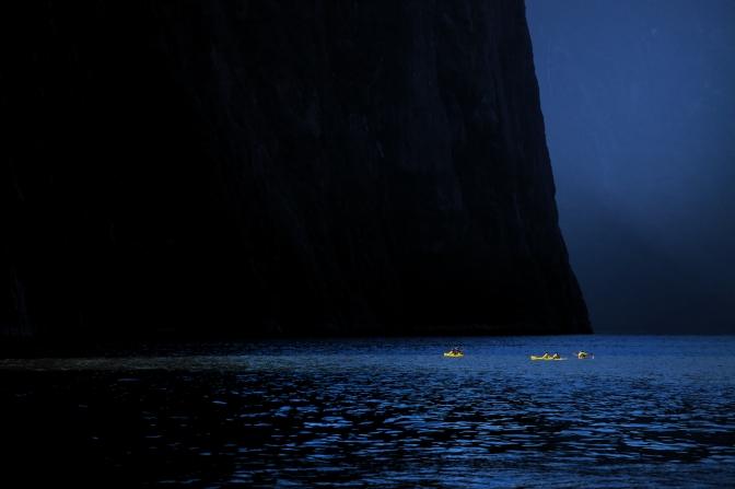 Kayakers dwarfed on Milford Sound