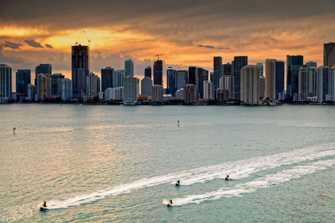 Jet ski racers and Miami CBD at sunset
