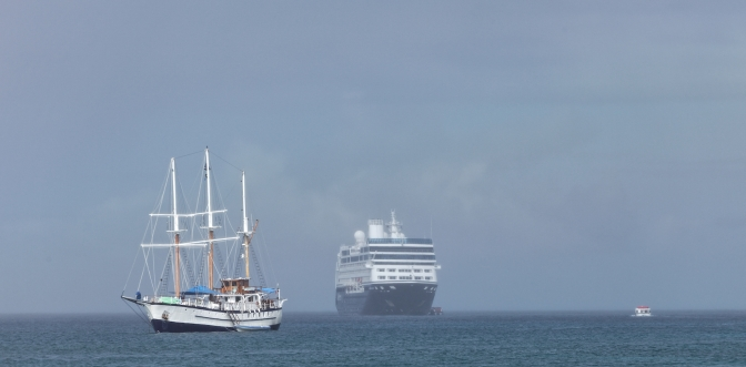Azamara Quest moored off the island of Nevis, with schooner