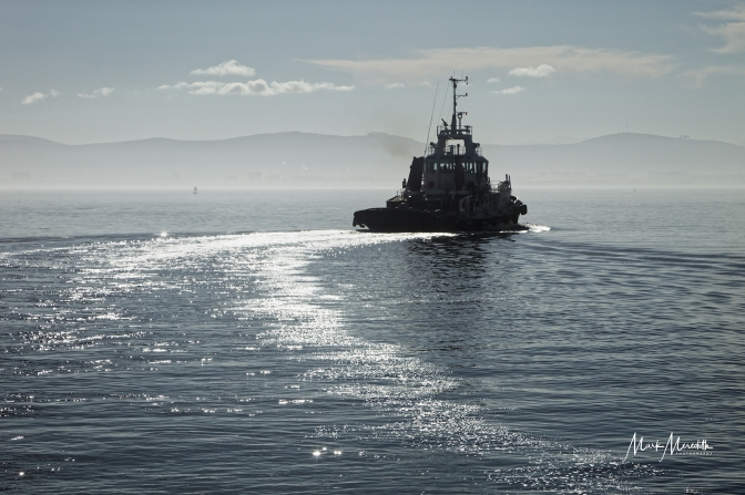 Tugboat heads out to sea, Cape Town