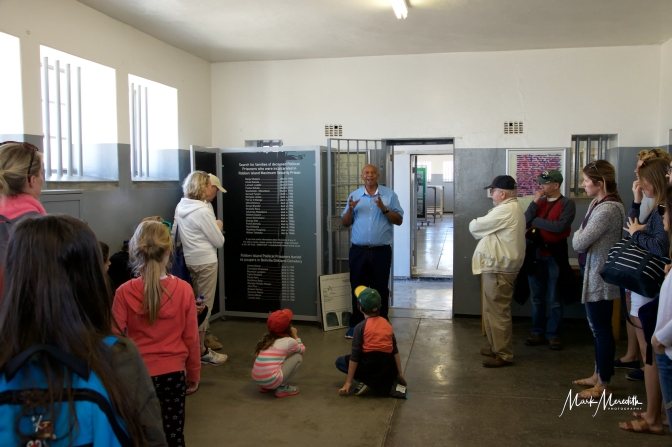Ex prisoner on Robben Island describes life in the prison to a tour group