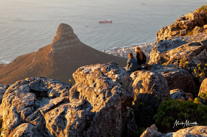 View over Lion's Head and Sea point enjoyed by two visitors